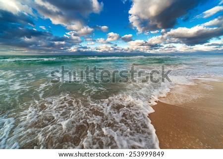 ocean and sandy beach on a sunny day - stock photo