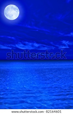 Ocean at midnight with a bright full moon - stock photo