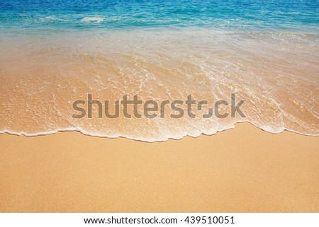 ocean background with soft waves on sandy ground - stock photo
