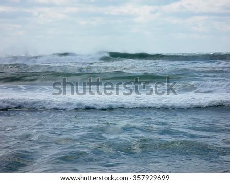Ocean beach and waves crashing onto the shore - stock photo