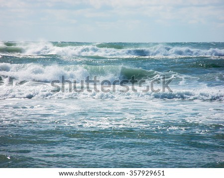 Ocean beach and waves crashing onto the shore abstract for background - stock photo