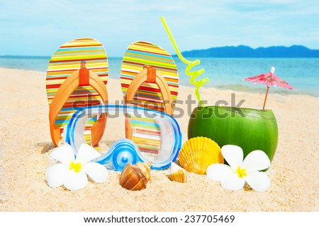 Ocean beach with palm and and coctail - stock photo