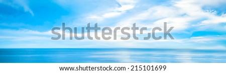 Ocean Blue Sky Cloudscape Panorama - stock photo