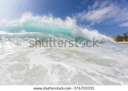 Ocean breaking surfing wave. Pipeline in bright sun light. Beautiful tropical oceanic background postcard. Big water splashes on seascapes. - stock photo