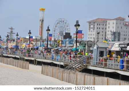 OCEAN CITY, NEW JERSEY - SEPTEMBER 1: Ocean City Boardwalk in New Jersey, as seen on September 1, 2013. The boardwalk is 2.5 miles long and one of the most well-known boardwalks in the world. - stock photo
