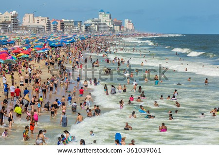 OCEAN CITY - SEPTEMBER 6: Crowded beach in Ocean City, MD on September 6, 2015. Ocean City, MD is a popular beach resort on the East Coast and one of the cleanest in the country. - stock photo