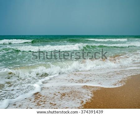 ocean coast and blue sky, ocean wave,sandy beach and blue sky - stock photo