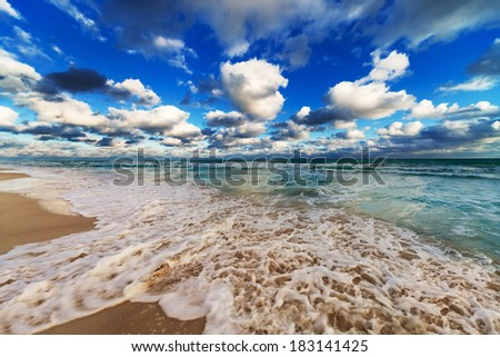 ocean coast with waves at sunrise