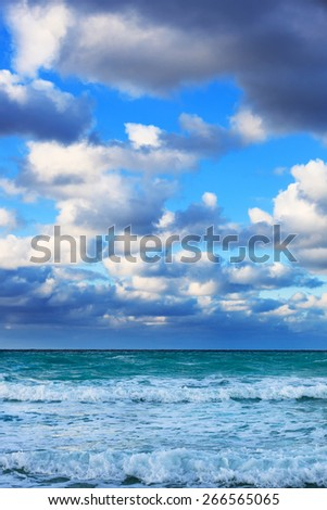 ocean coast with waves at sunrise - stock photo