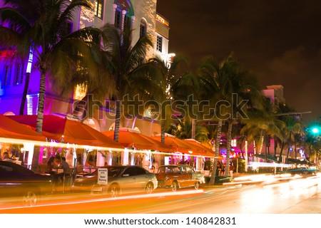 Ocean Drive scene at night lights, cars and people having fun, Miami beach. La noche de Ocean Drive en Miami Beach, Florida, Estados Unidos. - stock photo