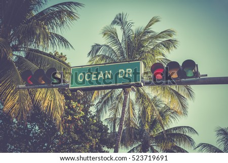 Ocean Drive sign with palm trees in Miami Beach, Florida. Vintage colors