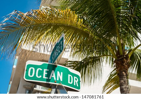 Ocean Drive street sign with palm tree in Miami Beach. - stock photo