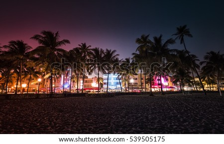 Ocean Drive street with illuminated buildings, South Beach , Florida. Vintage colors