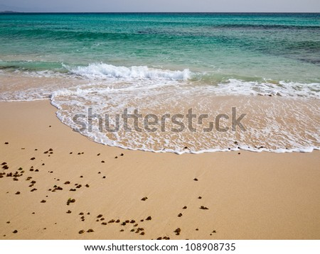 Ocean green waves and white foam on the sandy beach. Close-up. - stock photo