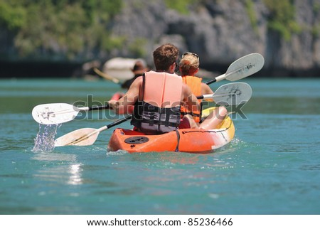 ocean kayaking backward view of traveler. - stock photo