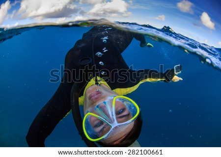 Ocean Life Water Sports Postcard. Underwater world with funny freediver near water surface - stock photo
