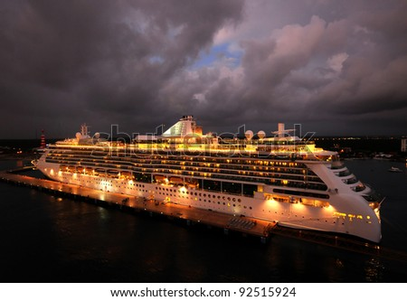Ocean liner brightly lit at night - stock photo