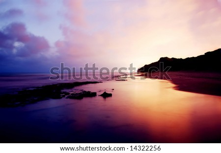 ocean long exposure on sunset colorful tones - stock photo