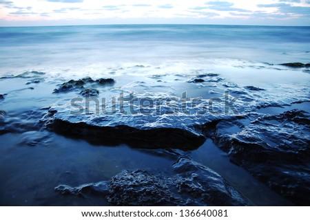 ocean night scene long exposure - stock photo