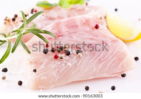 ocean perch fillet with fresh herbs and spices - stock photo