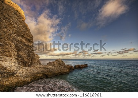 ocean rocks and clouds - stock photo