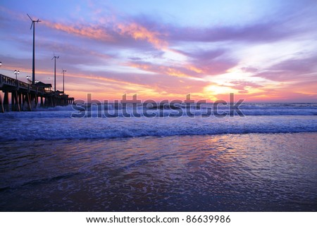 ocean shore and long pier and sun rise - stock photo