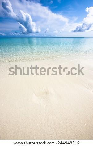 Ocean shore at noon, Kuramathi island - stock photo