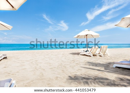 Ocean side chairs and umbrellas closeup  with blue sky and water giving the beauti of horizon - stock photo