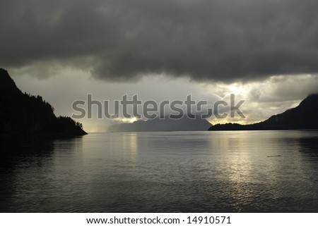 Ocean storm at sunset near Porteau Cove in Vancouver BC - stock photo