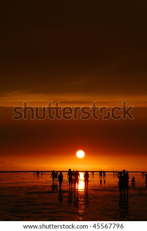 Ocean Sunrise with people - stock photo