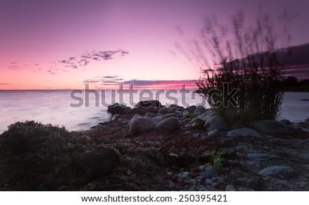 Ocean sunset, Swedish coastline  - stock photo