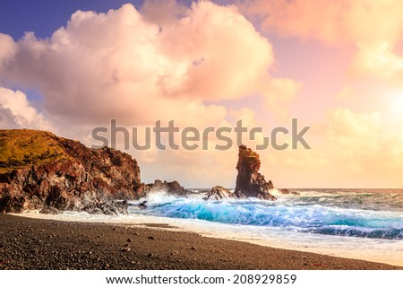 Ocean surf at the western coast of Iceland - stock photo