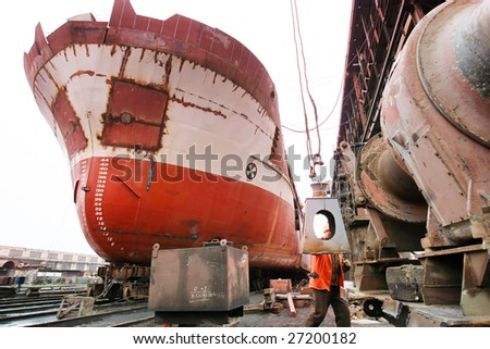ocean vessel under repair process in dry dock - stock photo