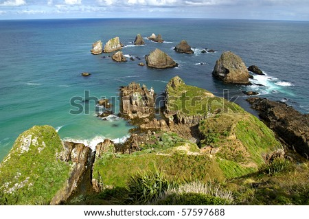 Ocean view over rugged rocks at the tip of Nugget Point, Catlins Coast, South Island, New Zealand - stock photo