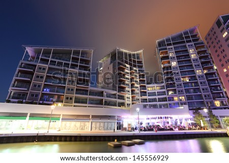 Ocean Village marina at night, Gibraltar - stock photo