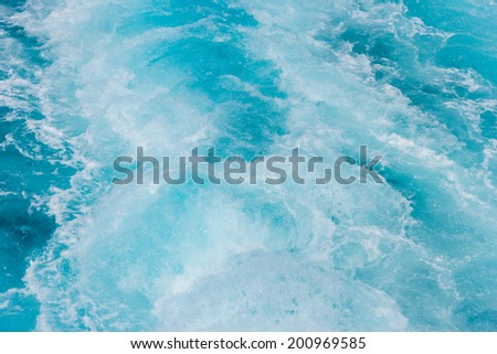 Ocean Wake in blue clear waters - stock photo