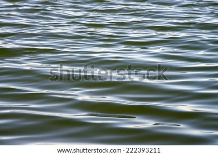 Ocean water in the bay rippling in the wind - stock photo