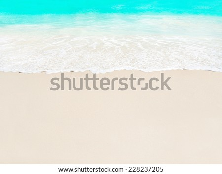 Ocean wave and white sand at tropical beach, island Praslin, Seychelles - vacation background - stock photo