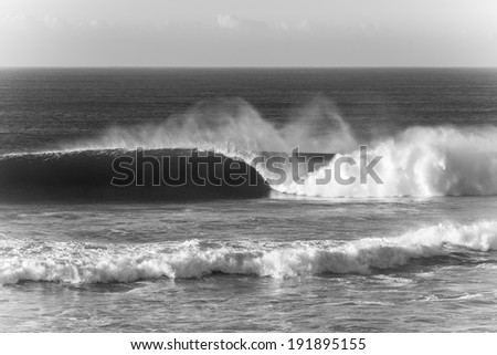 Ocean Wave Crashing Sepia Tone Ocean wave crashing along shallow reefs with natures power and energy in black and white tone for mood contrast.