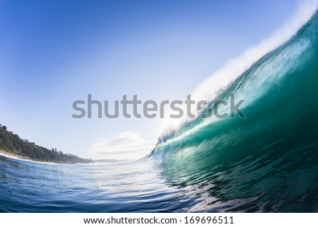Ocean Wave Crashing  Swimming view of wave surging forward and crashing onto shallow reefs and sandbars with energy and power