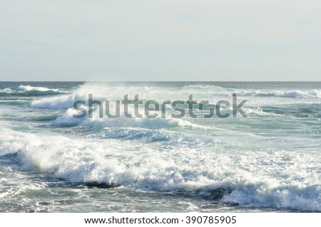 Ocean Wave During Monsun with cloudy clod - stock photo