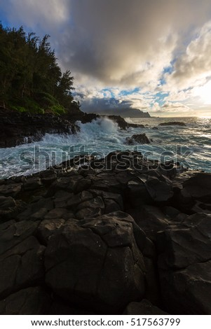 Ocean waves at sunset along the Queens Bath area of Kauai, Hawaii