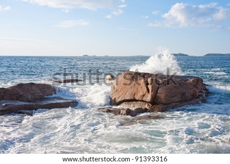 Ocean waves breaking at  the granite coast of France, Brittany - stock photo