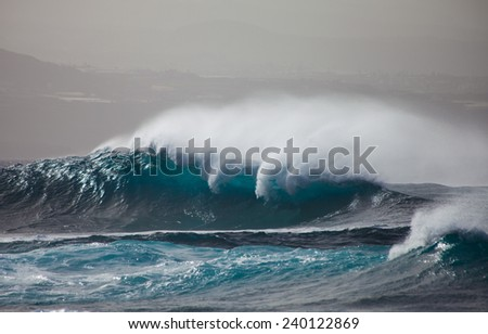 ocean waves breaking by the shores of Gran Canaria - stock photo