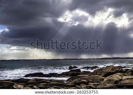 Ocean waves on rocky beach, Atlantic ocean, Bretagne, France - stock photo