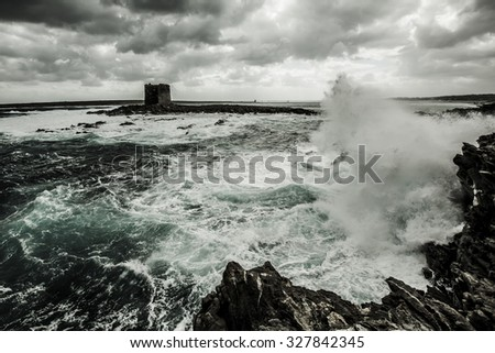 ocean waves on the rock - stock photo