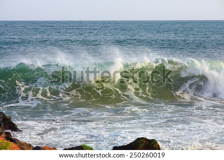 Ocean waves rolling up on shore - stock photo