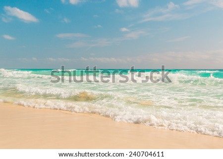Ocean waves, white sand beach, Caribbean sea, Cancun, Mexico.