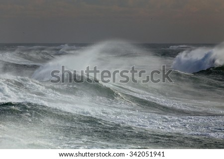 Ocean windy waves spraying. Portuguese coast in Autumn.