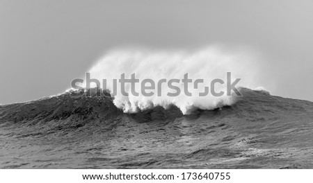 Ocean  with big wave on cloudy day. Black and white photo - stock photo